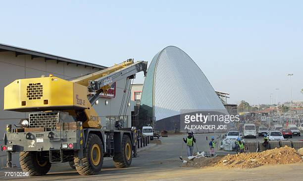 shopping heaven comes to antiapartheid bastion** South African workers put the finishing bit to the new shopping Maponya Mall in Soweto 25 September...