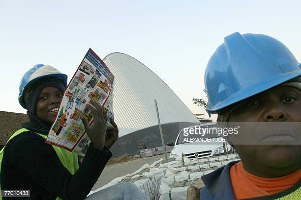 shopping heaven comes to antiapartheid bastion** South African workers are pictured on the site of the new shopping Maponya Mall in Soweto 25...