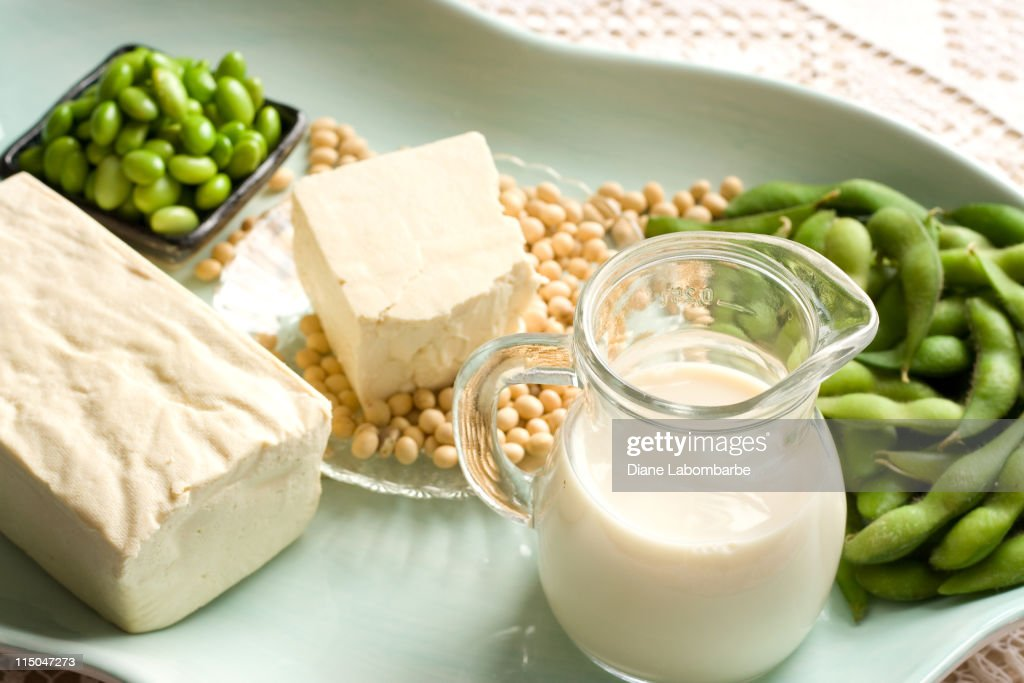 Soy Products with soybean pods, tofu, milk on serving dish : Stock Photo
