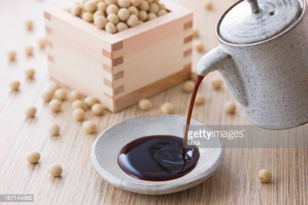 soy sauce and soybean - soy sauce stock pictures, royalty-free photos & images