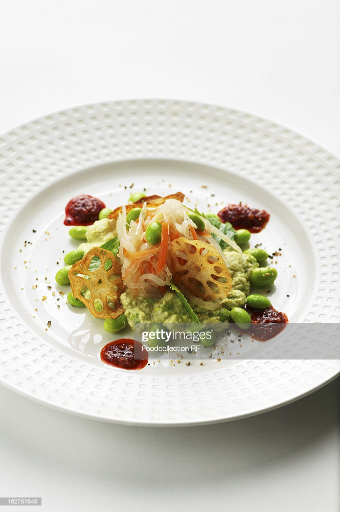 Soya bean salad with vegetables, lotus root and chilli sauce : Stock Photo