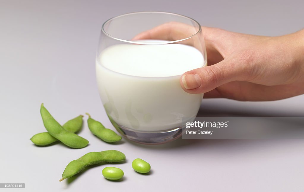 Soya beans and soya milk in glass : Stock Photo