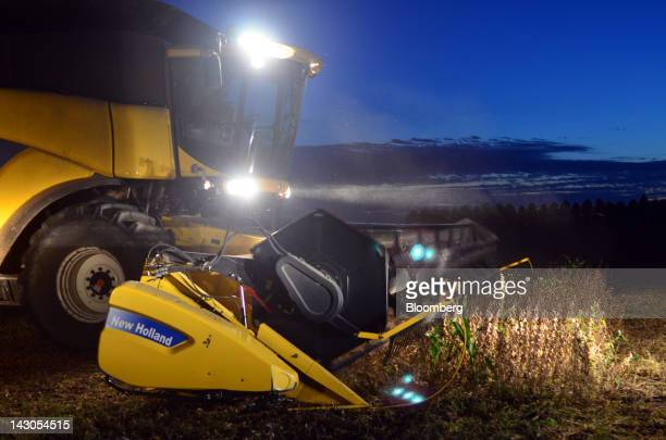 Soybeans are harvested at night in Capitan Sarmiento Argentina on Sunday April 1 2012 South America's soybean crop will turn out smaller than...