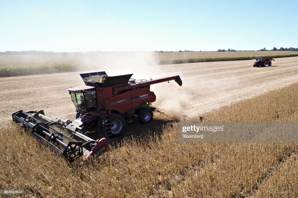 Soybeans are harvested with a Case IH Agricultural Equipment Inc. combine harvester in this aerial photograph taken above Princeton, Illinois, U.S., on Friday, Sept. 29, 2017. Soybean futures for November delivery rose 0.1% a bushel on the Chicago Board of Trade after falling as much as 0.5%, the lowest since September 13. Photographer: Daniel Acker/Bloomberg via Getty Images