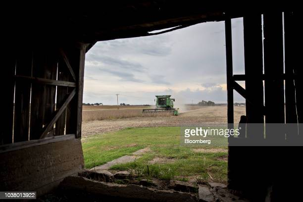 Soybeans are harvested with a Deere Co combine harvester in Tiskilwa Illinois US on Tuesday Sept 18 2018 With the trade war having a knockon effect...