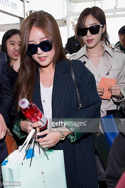 Soyeon and Eunjung of South Korean girl group Tara are seen on departure at Incheon International Airport on March 28 2015 in Incheon South Korea