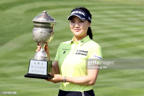 So-yeon Ryu of South Korea poses with the trophy after winning the tournament following the final round of the KIA Motors Korea Women's Open at the...