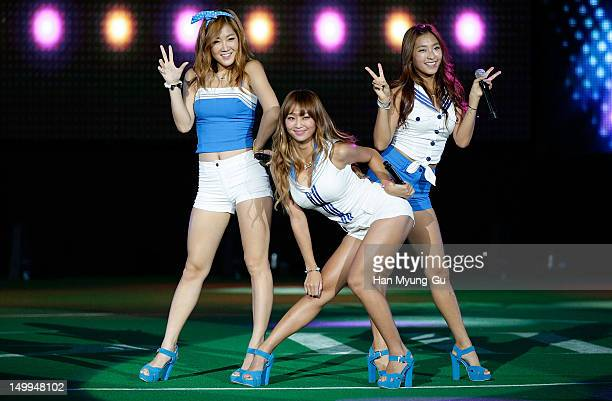 """Soyou, Hyorin and Bora of South Korean girl group SISTAR perform onstage during the Samsung Galaxy SIII Stadium """"Idol Big Match"""" on August 7, 2012 in..."""