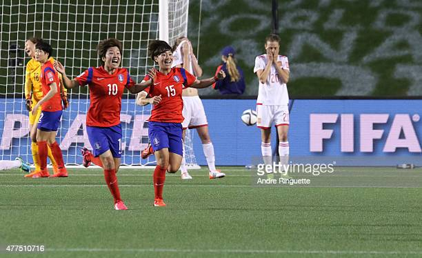 Soyun Ji and Heeyoung Park of Korea Republic celebrate their win as Irene Paredes of Spain looks on dejected after the FIFA Women's World Cup Canada...