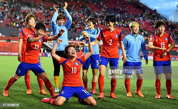 Soyun Ji of Korea celebrates with team mates after winning the FIFA Women's World Cup 2015 Group E match between Korea Republic and Spain at...