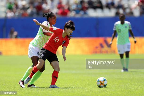 Soyun Ji of Korea Republic is challenged by Chinaza Uchendu of Nigeria during the 2019 FIFA Women's World Cup France group A match between Nigeria...
