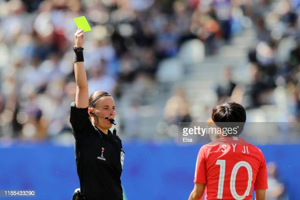 Soyun Ji of Korea Republic is shown a yellow card by referee Anastasia Pustovoitova during the 2019 FIFA Women's World Cup France group A match...