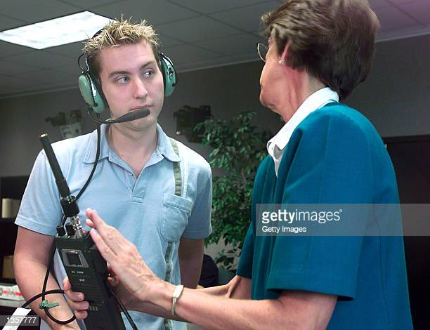 Soyuz 5 nominated space flight participant and NSync member Lance Bass is given HAM radio instructions from Carolynn Conley at Johnson Space Center...