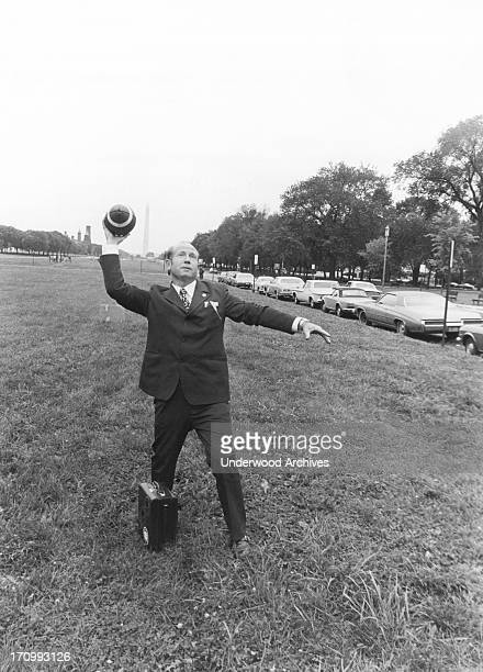 Soyuz Commander and Russian cosmonaut Alexei Leonov throws a football pass on the Capitol Mall Washington DC September 8 1974