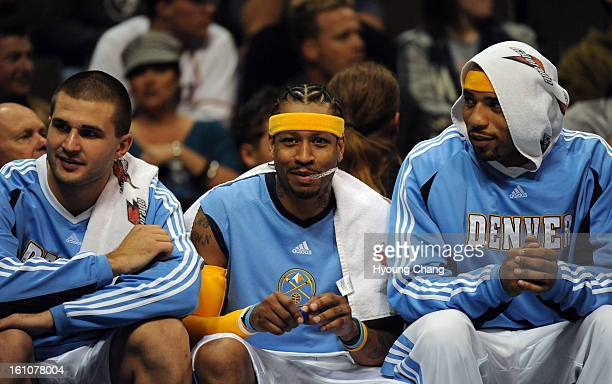 sp12bknbirdman From left Denver Nuggets Linas Kleiza Allen Iverson and Kenyon Martin are in the bench during the 2nd quarter of the preseason game...