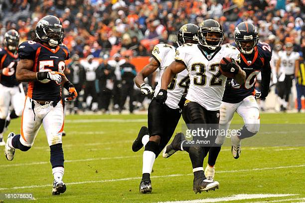 sp12BroncsJagsJA12l Denver Broncos chase after Jacksonville Jaguars Maurice JonesDrew during a long touchdown run in the 3rd quarter at Invesco Field...