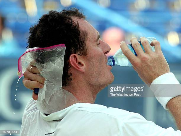 sp_legg1 7/31/06 182599 LEGG MASON TENNIS CLASSIC Post Photos by Rich Lipski Wesley Moddie sips a cold bottle of water while the mettling ice bag...