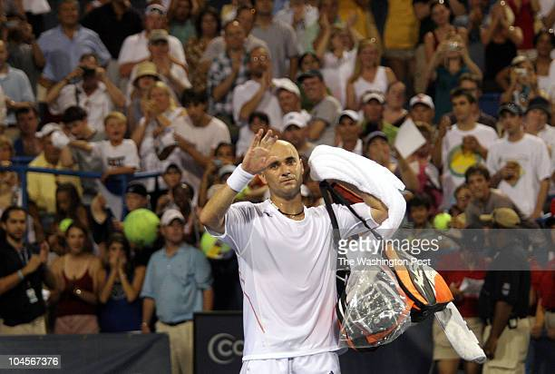 sp_legg1 8/1/06 182607 LEGG MASON TENNIS CLASSIC Post Photos by Rich Lipski ANDRE AGASSI VS ANDREA STOPPINI A dejected Andre Agassi waves goodbye to...