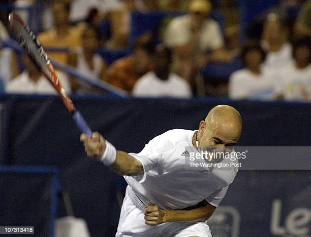 sp_legg1 8/1/06 182607 LEGG MASON TENNIS CLASSIC Post Photos by Rich Lipski ANDRE AGASSI VS ANDREA STOPPINI Andre Agassi puts his all into slamming...