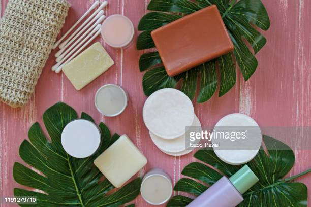 spa and cosmetic products on pink background - hergestellter gegenstand stock-fotos und bilder