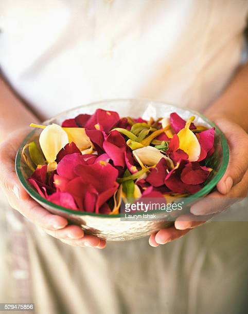 Spa attendant holding a bowl of potpourri at Samaya Villas and Spa Resort