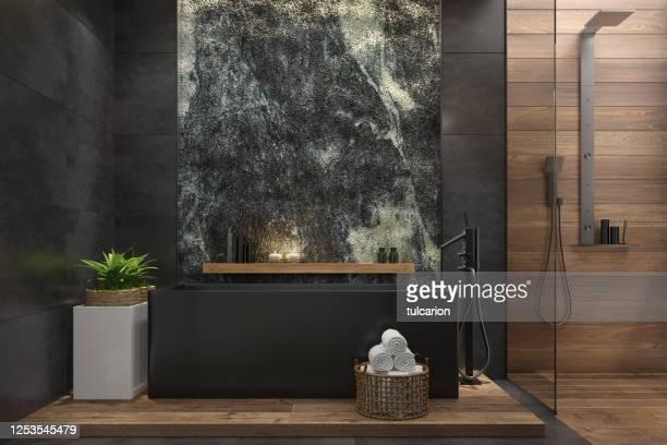salle de bains spa dans la villa moderne luxueuse avec le mur de roche naturel énorme - massage room photos et images de collection