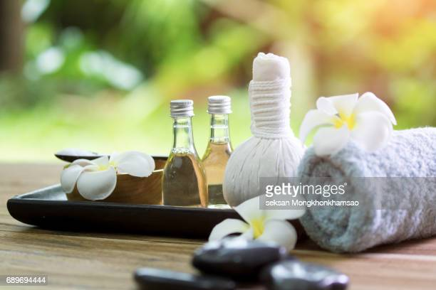 spa massage compress balls - spa treatment stock pictures, royalty-free photos & images