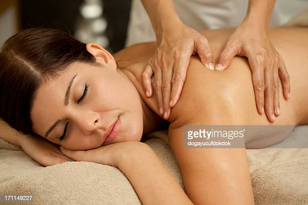 spa massage xxxl - sensual massage stock photos and pictures