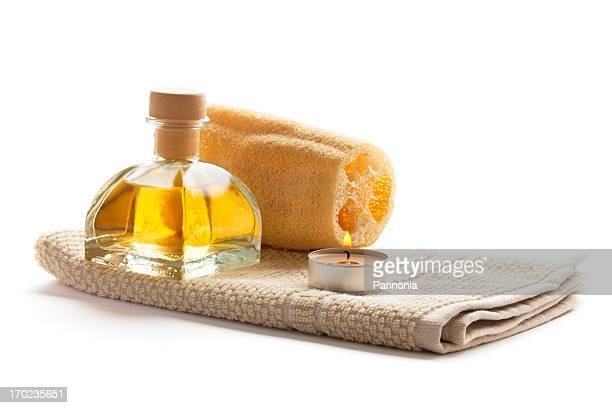 Spa setting with candle, towel and loofah