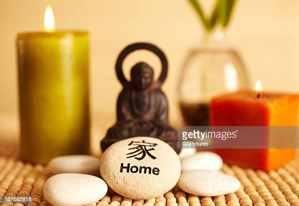 spa still life buddha statue and candles, home pebble - feng shui stock photos and pictures