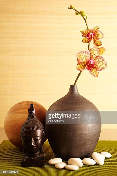 Spa still life of orchid flower in vase and budhha