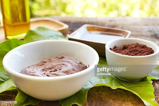 Spa still life with mud mask powder and massage oil