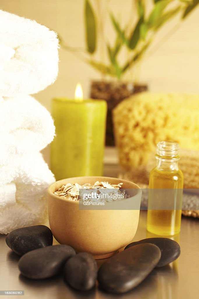 Spa still life with oatmeal, candle, essential oil : Stock Photo