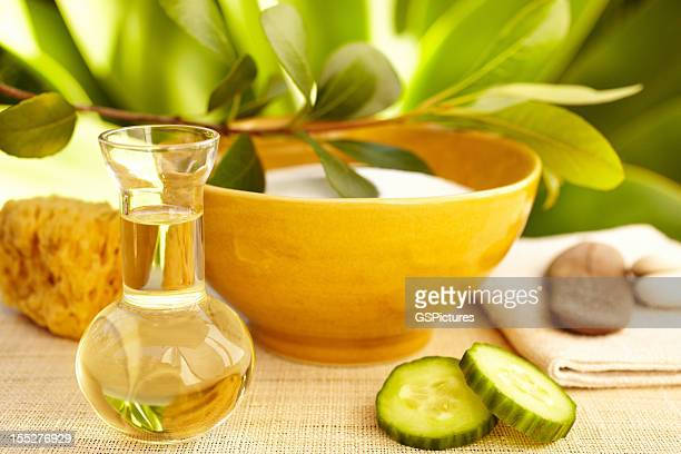 spa still life with organic mud mask and massage oil - cloth face mask stock pictures, royalty-free photos & images
