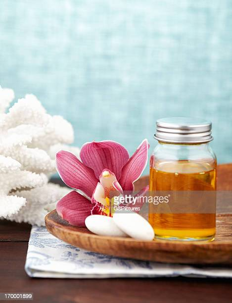 Spa still life with purple orchid, honey, pebble stone, washcloths