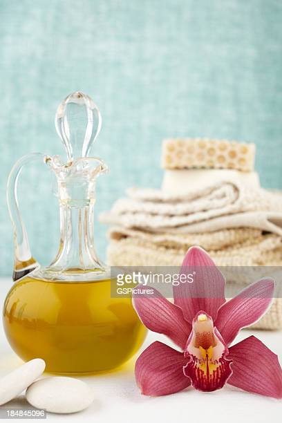 Spa still life with purple orchid, oil massage, soap, washcloths