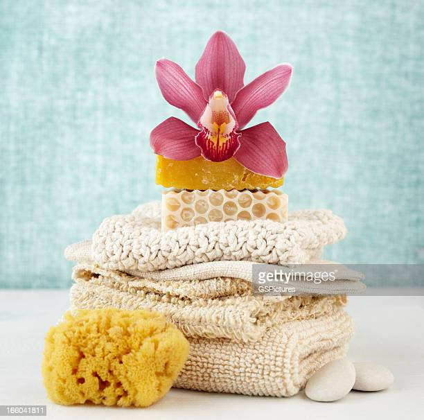 Spa still life with purple orchid, soap, washcloths and sponge
