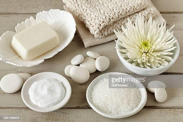 Spa still life with soap, bath salt, flower, washcloth, pebbles