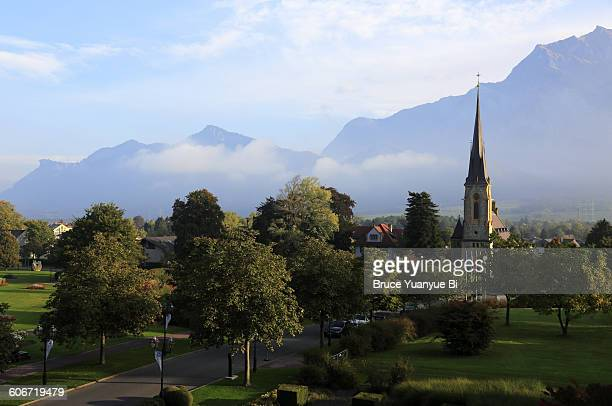 spa town of bad ragaz with evangelical church - bad ragaz stock pictures, royalty-free photos & images