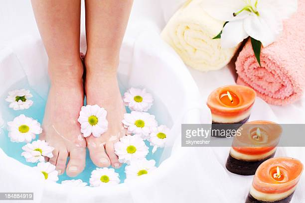 Spa treatment.  Legs in blue water