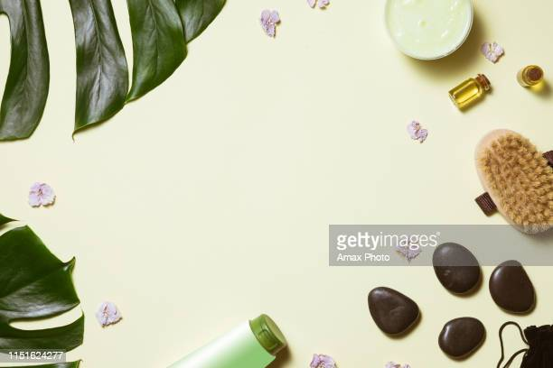 spa treatment on pastel yellow background, flat lay. top view of beauty bath background for body care and wellness - aromatherapy stock pictures, royalty-free photos & images