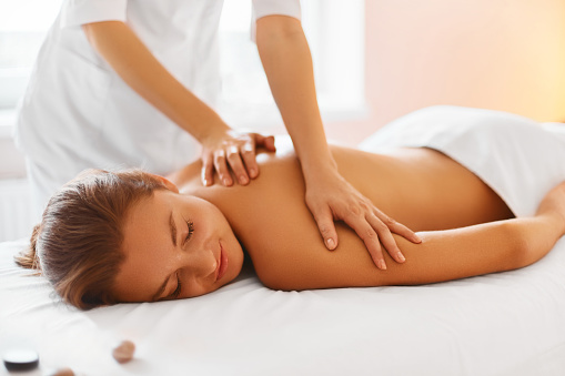 Spa Treatment. Woman enjoying Massage in Spa centre. 492676612