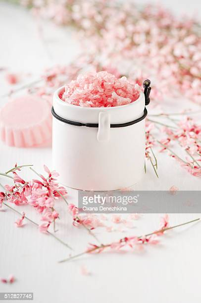 Spa with pink salt, flowers and soap