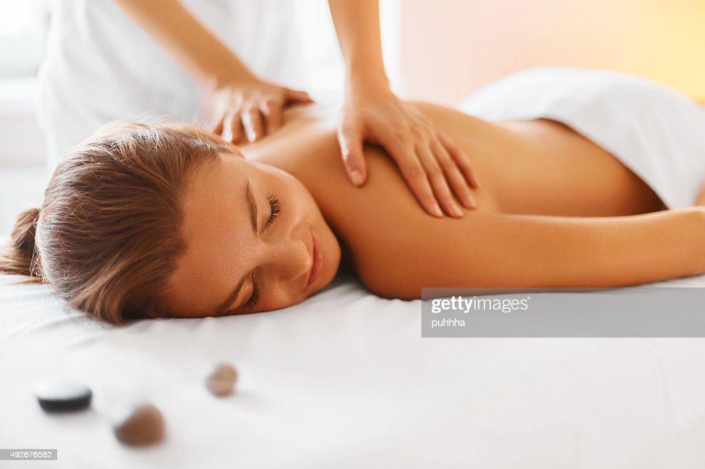 Spa Woman. Female Enjoying Massage in Spa Centre. : Stock Photo