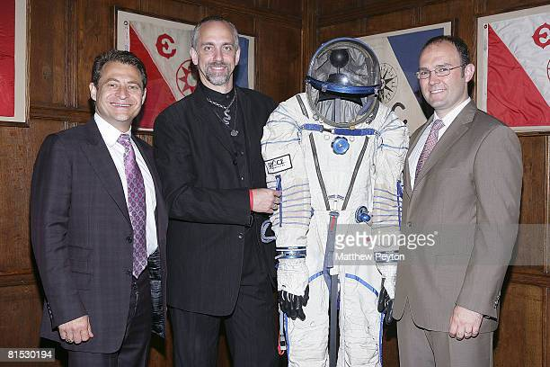 Space Adventures cofouder Peter Diamandis video game mogul and space tourist Richard Garriott and Space Adventures cofounder Eric Anderson pose with...