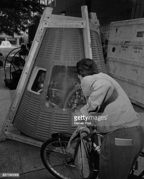 Space Capsule Displayed An unidentified cyclist got the first look at this Mercury space capsule the type used to carry astronaut Alan Shepard into...