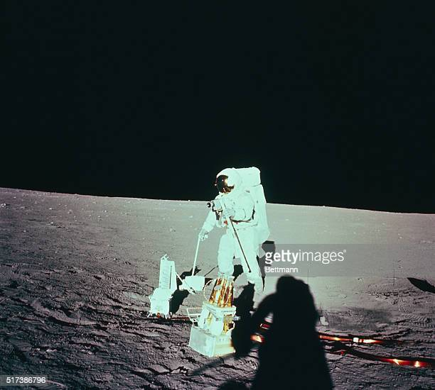 An Apollo 12 astronaut deploys Apollo Lunar Surface Experiment Package on moon November 19th On lunar surface were commander Charles Conrad and lunar...