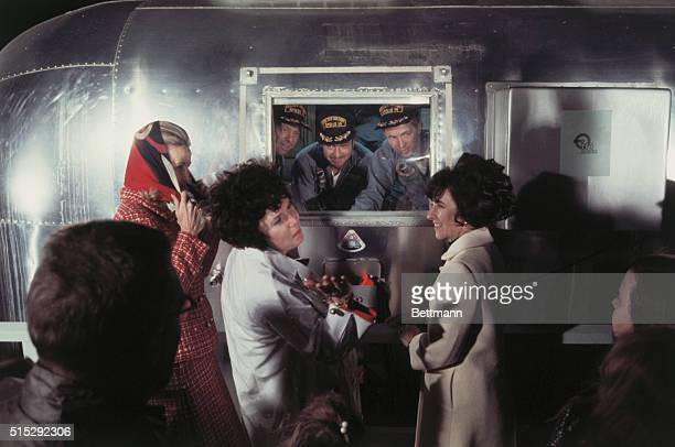 Apollo 14 astronauts Alan Shepard Edgar Mitchell and Stuart Roosa in quarantine trailer are welcomed home by their wives Louise Shepard Joan Rosa and...