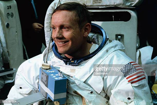 Astronaut Neil A Armstrong in training for the projected Apollo 11 lunar landing mission is being suited up for the first full dress rehearsal of...