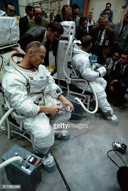 During a break in training for the Apollo 11 lunar landing mission astronaut Buzz Aldrin holds a lunar tool designed for use in picking up rock or...